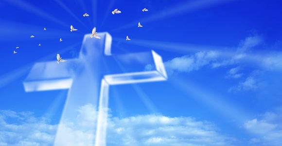 beaming cross in blue sky